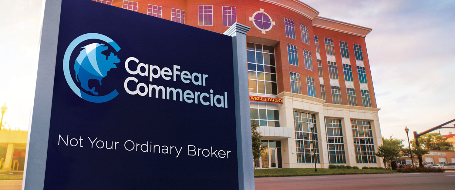 Cape Fear Commercial - CFC sign in front of Wells Fargo building