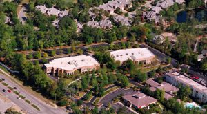 Wilmington law firm Murchison, Taylor & Gibson is relocating its main operations to Landfall Park, in the building called Landfall Park South (left). (Photo courtesy of Cape Fear Commercial)