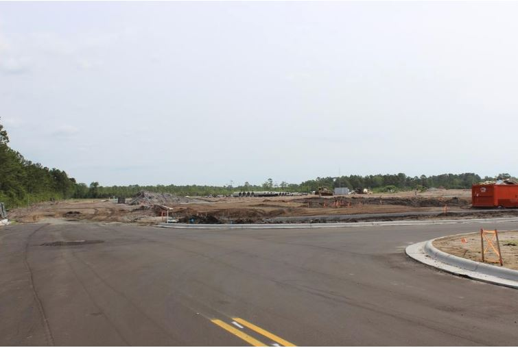 Roads and infrastructure are in place for the new Southport Crossings shopping center at the corner of N.C. 133 and N.C. 211. The center recently accepted its first tenant, a CVS Pharmacy.